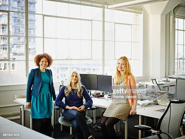 Group of smiling businesswomen in office