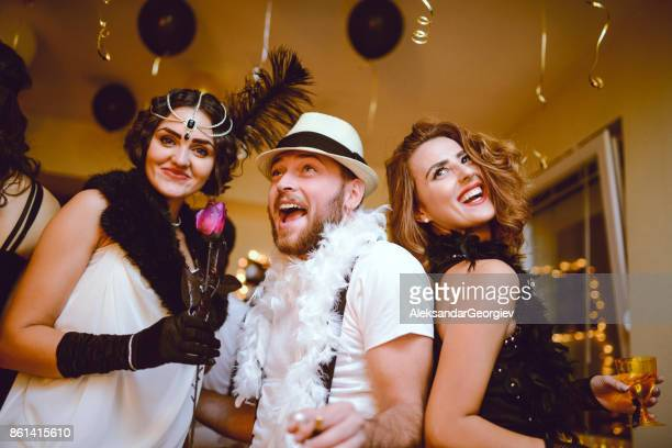 Group of Smiling Friends Having Great Party at Night