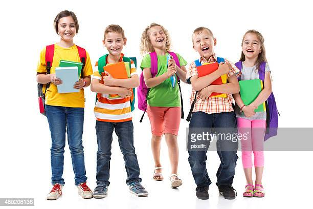 Group of smiling kids with school supplies