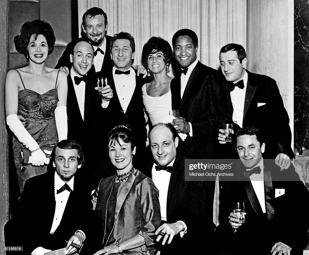 A group of some of the most important producers and songwriters of the 1960's (clockwise from top left: Evelyn Kingsley, Mike Stoller, Bert Berns, Paul Case, Zelda Samuels, Sam Cooke, Jerry Leiber, Barry De Vorzon, Danny Kessler, Mrs Danny Kessler, <a gi-track='captionPersonalityLinkClicked' href=/galleries/search?phrase=Phil+Spector&family=editorial&specificpeople=239134 ng-click='$event.stopPropagation()'>Phil Spector</a>) pose for a portrait circa1963 in New York City, New York.