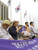 A group of South Korean women who were forced to work in Japan's wartime military brothels hold a press conference in Seoul on July 25 in response to...
