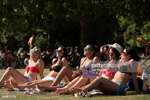 A group of spanish woman relax in the sunshine in Hyde Park on August 22 2015 in London England Weather in the capital is expected to reach 30...