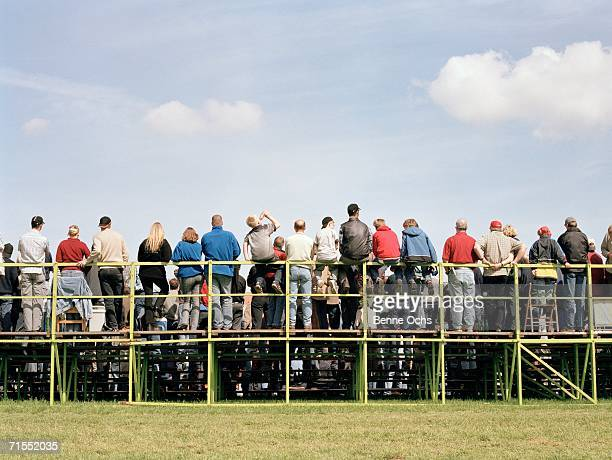 Group of spectators watching from bleachers