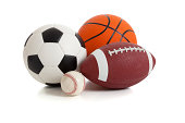 A group of sports balls on a white background including a baseball, basketball, a soccer ball and a football