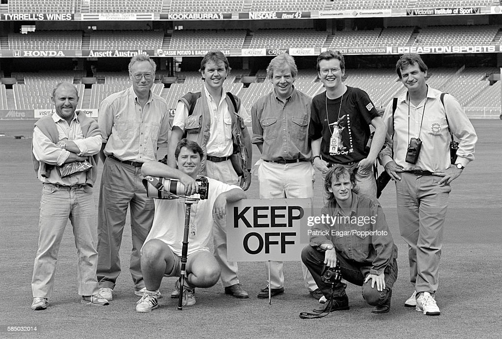 A group of sports photographers from England posing for a 'team group' at the Melbourne Cricket Ground prior to the World Cup match between Australia...