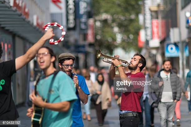 Group of street musicians in Cologne has fun