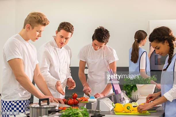 Group of Student Chefs Learning with Instructor