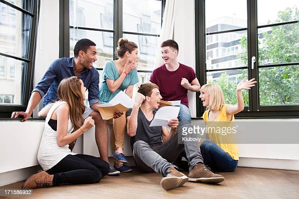 Group of students checking their exam results