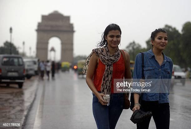 Group of Students enjoying rain at India Gate in New Delhi