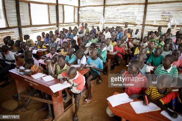 Group of students in a school at the Rhino Refugee Camp Settlement in northern Uganda Here children of local people and refugees are taught together...