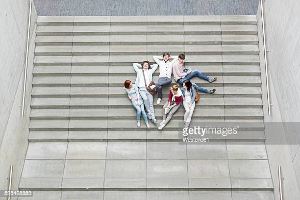 Group of students lying on stairs