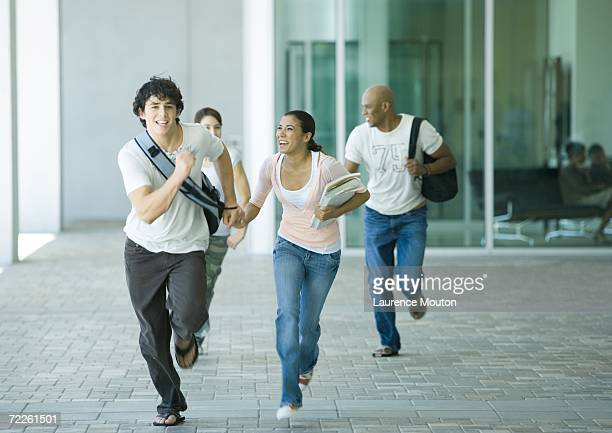 Group of students running on campus