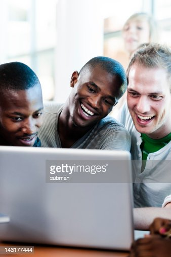 Group of students searching the web together