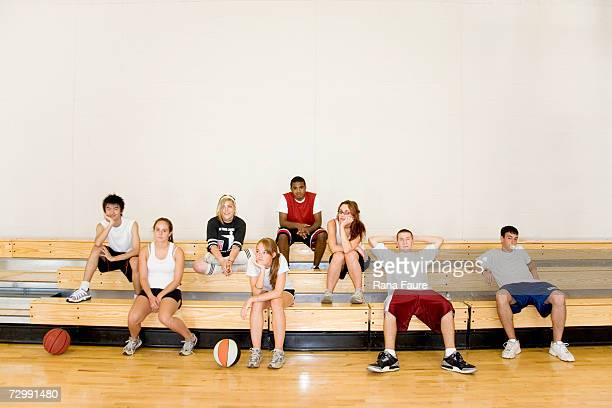 Group of students (16-19) sitting on bleachers in school gym