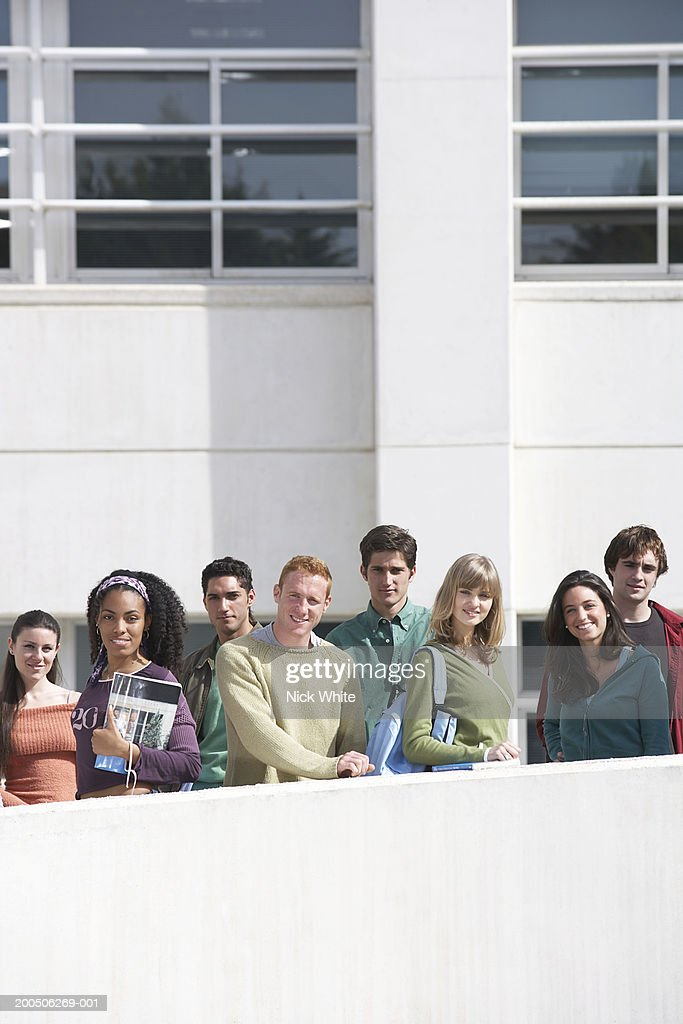 Group of students standing on walkway, outdoors, portrait : Stock Photo