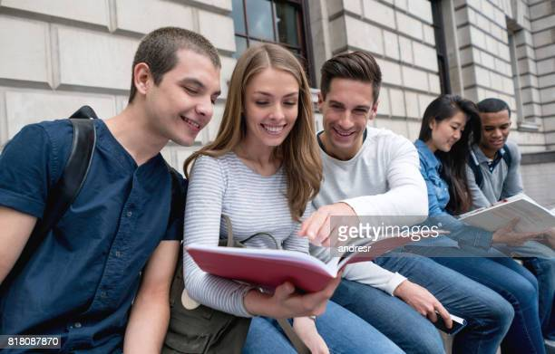 Group of students studying outdoors in London