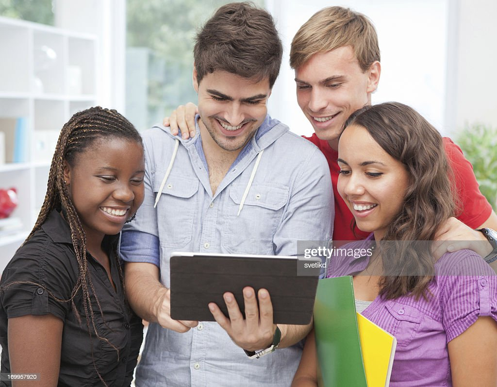 Group of students studying together. : Stock Photo
