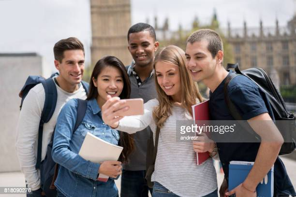 Group of students taking a selfie outdoors