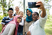 Group of students using mobile phone