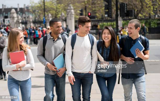 Group of students walking on the street looking very happy
