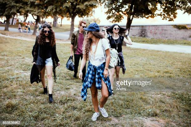 Group of stylish friends going to a jazz music festival