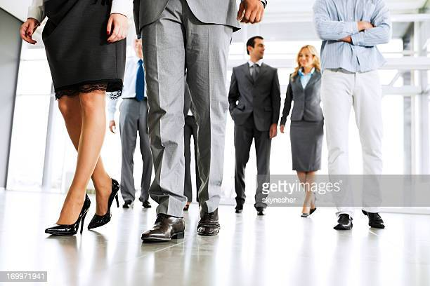 Group of successful businesspeople entering the building.