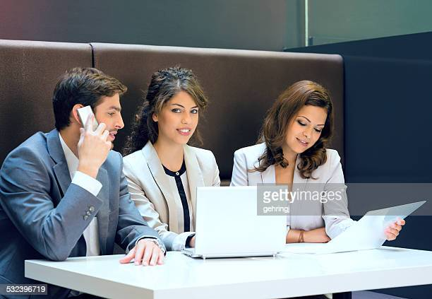 Group of successful businesspeople on a meeting.
