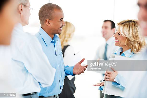Group of successful businesspeople standing and talking.