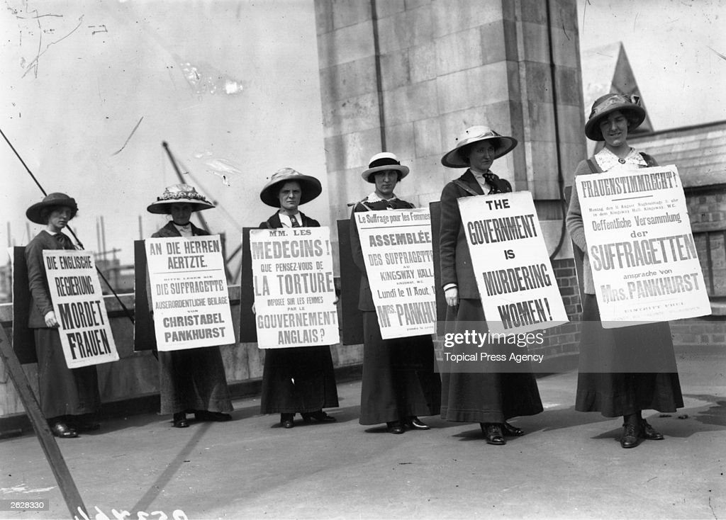 A group of suffragette women demonstrating with placards in English, French and German condemn the British government, June 1914. They are demonstrating after the illegal sedation of Grace Roe in Holloway prison. Roe was at the time the Suffragettes' operational leader.