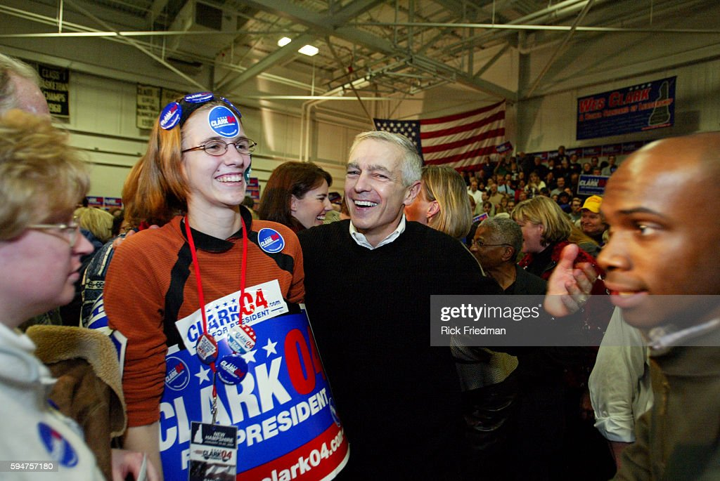 A group of supporters gather around Democratic presidential hopeful former General Wesley Clark during a campaign stop at Pembroke Academy