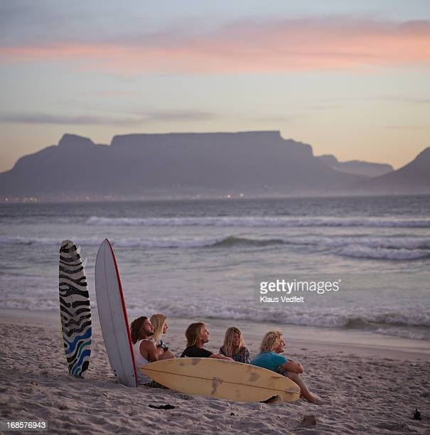 Group of surfers hanhing out at beach
