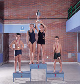 Group of Swimmers on Podium