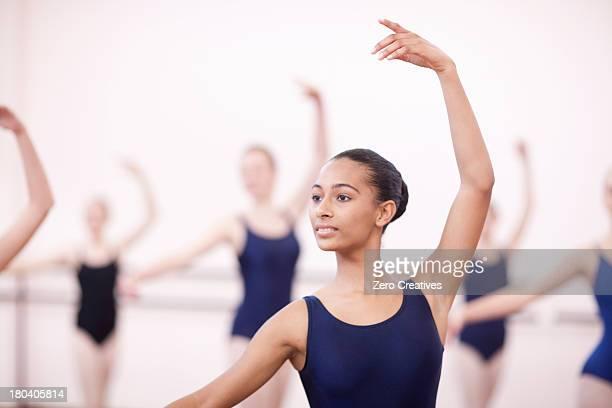 Group of synchronized teenage ballerinas