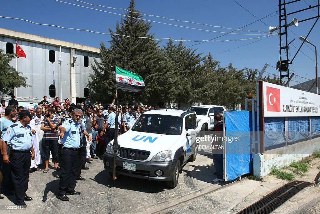 A group of Syrian refugees chant slogans 'freedom to syria' as International peace envoy for Syria arrives in the Altinozu camp in Hatay city, located on the border with their violence-racked homeland, on September 18, 2012. The Altinozu camp is one of the first refugee camps set up by Turkey soon after the unrest erupted in Syria mid-March 2011, which has already killed 20,000 according to UN figures and forced 250,000 to flee into neighbouring countries.