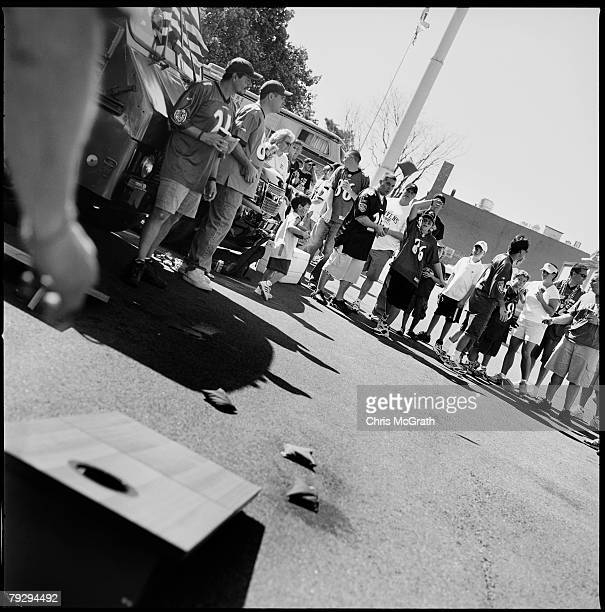 A group of Tailgaters play a game of cornhole a traditional tailgating game prior to the start of the NFL game between the Baltimore Ravens and the...