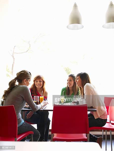 Group of teenage females in cafe