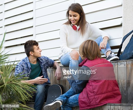 Group of teenage friends chatting and having fun : Stock Photo