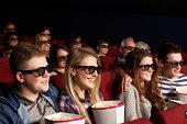 Group Of Teenage Friends Watching 3D Film In Cinema