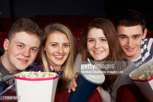 Group Of Teenage Friends Watching Film In Cinema : Stock-Foto
