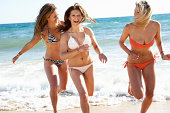 Group Of Teenage Girls Enjoying Beach Holiday Together
