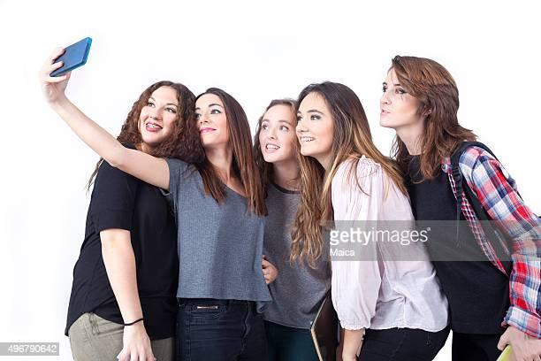 Group of teenage women making selfie