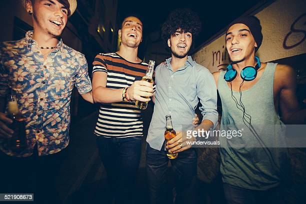 Group Of Teenager Friends Partying Together In Street
