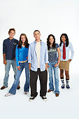 Group of teenagers (15-19) against white background, portrait