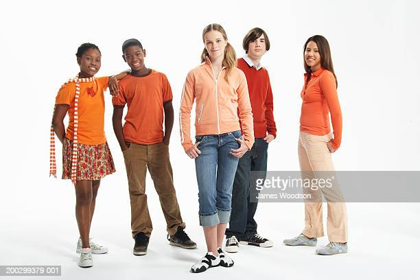 Group of teenagers (14-16) against white background, portrait