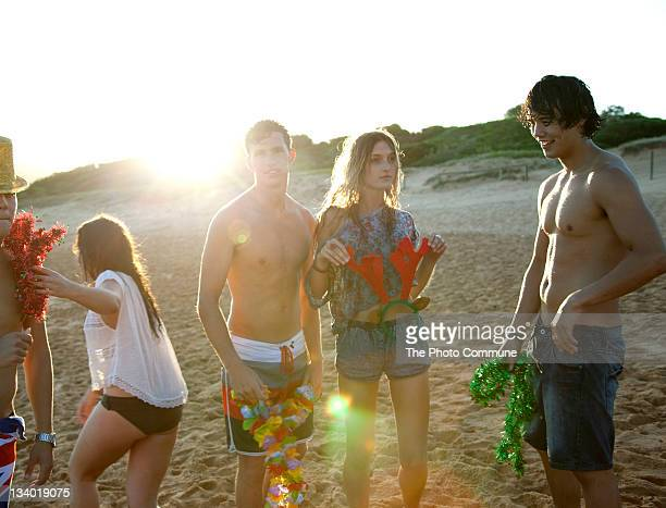 Group of teenagers at Christmas on beach