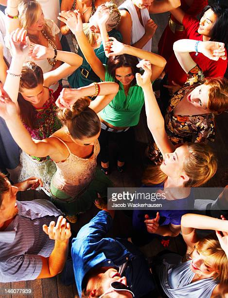 Group of teenagers enjoying party at disco