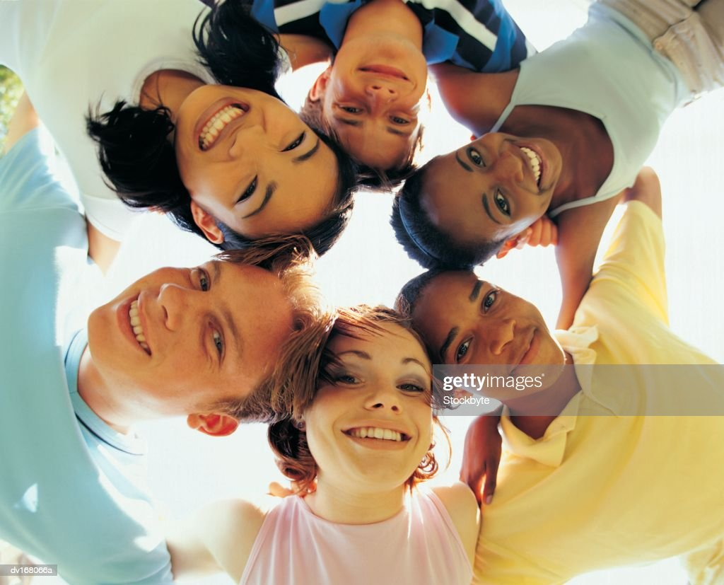 Group of teenagers in huddle : Stock Photo
