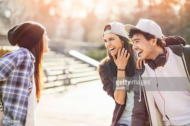 Group of teenagers meet on the street