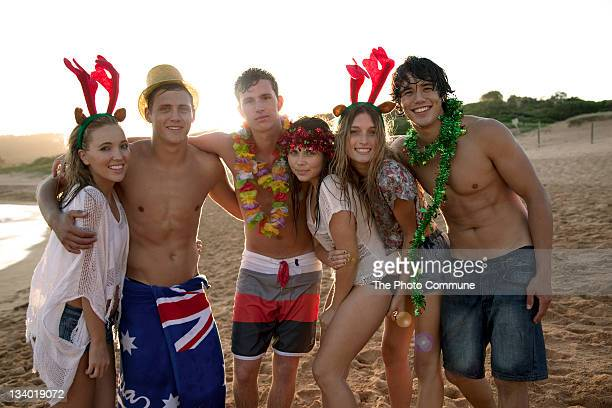 Group of teenagers on the beach at Christmas
