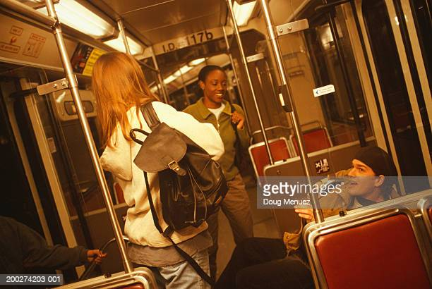Group of teenagers (16-17) on underground train